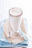 White chocolate milkshake in tall glass Royalty Free Stock Images