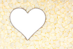White chocolate morsels surround a silver heart. Insideof the heart is white stock photography