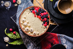 White chocolate mousse cake on a dark background. stock photo