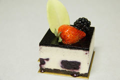 White chocolate mousse cake with dark cherries Royalty Free Stock Photography