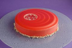 Cake with white chocolate mousse and red glaze Stock Images