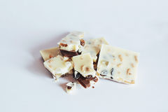 White chocolate with nuts, raisins on a background Stock Image