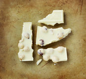 White chocolate on an old rustic stone chopping board Stock Photo