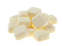 White chocolate pieces isolated on white background Stock Images