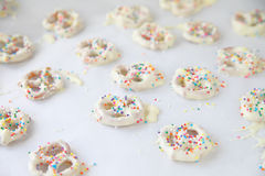 White chocolate pretzels with sprinkles Stock Image