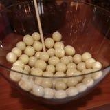 White Chocolate Sugared Almonds inside Glass Bowl.  stock photos