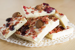 White chocolate. Sweet chocolate, almonds, berries dessert Royalty Free Stock Photo