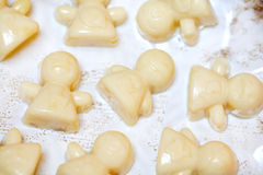 White chocolate truffles in shapes of little girls Royalty Free Stock Image
