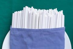 White Chopsticks fabric wrap on green background Royalty Free Stock Image