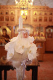 White christening candle with toy inside a orthodox church Stock Photography