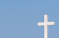 White Christian cross on blue sky. Background Royalty Free Stock Photography