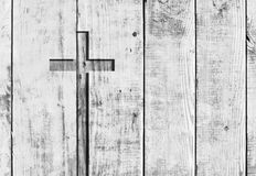 White christian religion symbol cross. White old christian religion symbol cross shape as sign of belief on a grungy textured church wall or rustic aged royalty free stock photos