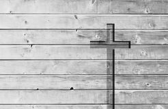 White christian religion symbol cross shape. White old christian religion symbol cross shape as sign of belief on a grungy textured church wall or rustic aged Stock Photo