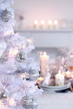 White Christmas. Place setting for Christmas in white with white Christmas tree Stock Photography