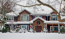 White Christmas 2. Large house with Christmas decorations covered with snow Royalty Free Stock Photography