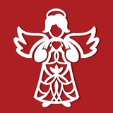 White Christmas Angel whith heart in his hands on the red background. Silhouette of Angel may use for card, laser. cutting, plotte Royalty Free Stock Photos