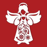 White Christmas Angel whith heart in his hands on the red background. Silhouette of Angel may use for card, laser. cutting, plotte Royalty Free Stock Photo