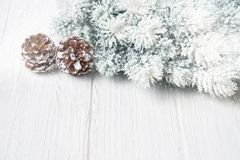 White Christmas background. Christmas fir tree branches with decoration. Copy space. Stock Photos