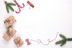 Free White Christmas Background. Frame With Christmas Gifts And Candy Cane, Decorations , Fir Branches Top View . Mock Up Template De Stock Image - 130838201