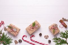 Free White Christmas Background. Framewith Christmas Gifts And Candy Cane, Decorations , Pine Cones, Fir Branches Royalty Free Stock Photo - 130599295