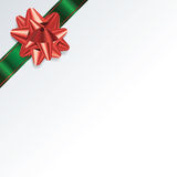 White Christmas Background with Green and Red Bow and Ribbon Royalty Free Stock Photography