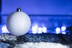 White Christmas Ball in Blue Ambient Light. Sparkly White Christmas Ball in Blue Ambient Light royalty free stock photo
