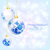 White christmas ball with blue floral ornament. And golden ribbon Stock Photo