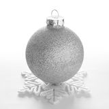 White Christmas Ball and Decorative Snowflake on the White Background Stock Photo