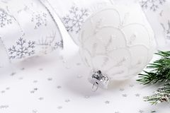 White Christmas ball,fir branch and ribbon.Christmas decoration. On white background Royalty Free Stock Photo