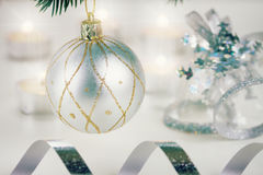 White christmas ball hanging on fir tree Stock Images