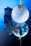 White Christmas Ball  on mirror /Blue light Royalty Free Stock Images