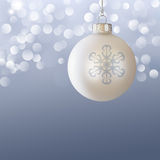 White Christmas Ball Ornament Elegant Blue Gray. White Christmas Ball Ornament Over Elegant Blue Gray Blurred Christmas Light Bokeh Background Royalty Free Stock Photos