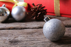 White christmas ball ornament on wooden surface Stock Photos