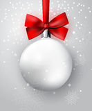 White Christmas ball with red bow Stock Image