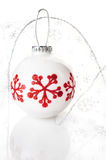 White Christmas ball with red snowflakes Stock Photos