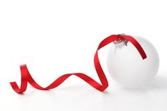 White christmas ball with ribbon Royalty Free Stock Images