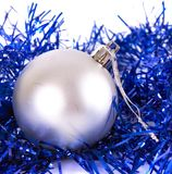 White christmas ball with tinsel. On white Stock Images