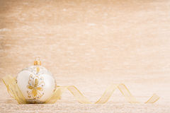 White Christmas Ball With Ribbon Stock Photo