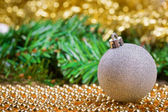 White christmas ball on yellow beads Stock Image