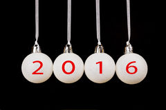 White christmas balls on black background with new year 2016 Stock Photography