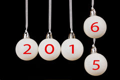 White christmas balls with dates 2015 and 2016 Stock Image