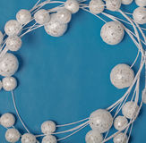 White christmas balls decorations on blue background border Stock Photos