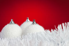 White christmas balls over bright red Royalty Free Stock Image