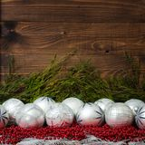 White christmas balls  and red beads with wooden Stock Photography