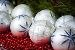White christmas balls  and red beads with wooden Royalty Free Stock Photo