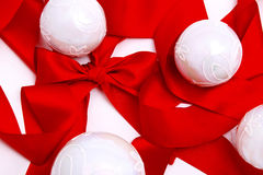 White christmas balls on red ribbon Stock Image