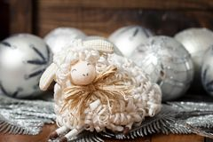 White christmas balls and sheep with wooden. White balls and sheep with wooden background Stock Photo