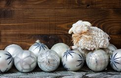 White christmas balls and sheep with wooden. White balls with nice and cute sheep on wooden background Stock Images