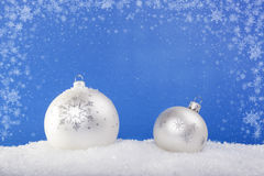 White Christmas balls in the snow Royalty Free Stock Images