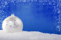 White Christmas balls in the snow Stock Images